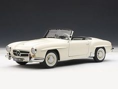 This Mercedes-Benz 190 SL Convertible Diecast Model Car is White and features working steering, suspension, wheels and also opening bonnet with engine, boot, doors. It is made by AUTOart and is 1:18 scale (approx. 25cm / 9.8in long).    Features removable soft top....