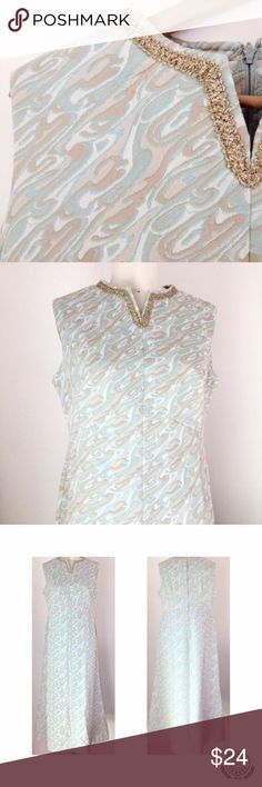 """VINTAGE 60s Maxi Dress Women's Size L This gorgeous vintage poly 60s dress has a textured patterned double knit in light blues, beiges and ivory. Metallic gold trim on the neckline and super flattering bust darts and curved empire waist seam. Lovely subtle A line silhouette.  This gem of a dress is in perfect condition, ready to wear and ship.  Size: L MEASUREMENTS:  LENGTH: 52"""" BUST:  40"""" EMPIRE WAIST: 36"""" HIPS: 44"""" Vintage Dresses Maxi"""