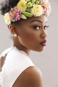 5 Brides that accessories their natural hair with beautiful floral headpieces. These are stunning photos of brides with natural hair.  http://www.culturewedding.ca/5-brides-that-accessories-natural-hair-with-floral-headpieces/