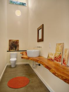 """This is a really long room, but a smaller version of this would be cool. I like the counter. It's not a MUST. Adam doesn't love bowl sinks like this, but I think it is because he has experienced a slow draining one. 'Ehem, it was cheap. Half baths are usually boring. Something """"special"""" would make it better..."""