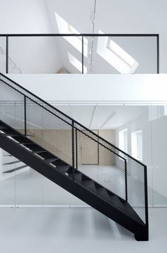 handrail and supports expressed through the use of mesh infill panel