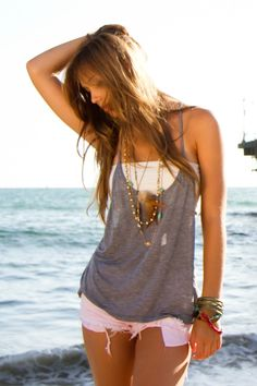 light grey talia tank - loose with racer back over a white tube top with short white shorts.