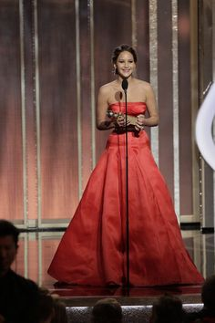 Jennifer Lawrence accepts the Best Actress award for Motion Picture, Comedy or Musical on stage during the 70th Annual Golden Globe Awards at the Beverly Hilton Hotel International Ballroom on January 13, 2013 in Beverly Hills, California.