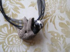Three toed Sloth necklace by rudeandreckless on Etsy, $30.00