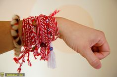 Bulgarians may wear the martenitsa (мартеница) – an adornment made of white and red yarn and worn on the wrist or pinned on the clothes – from 1 March until the end of the month. Alternatively, one can take off the martenitsa earlier if one sees a stork (considered a harbinger of spring). One can then tie the martenitsa to the blossoming branch of a tree. Family-members and friends in Bulgaria customarily exchange martenitsas, which they regard as symbols of health and longevity