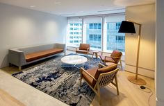 Tailored Lounge by Ross Gardam, Blava Easy Chair by Atelier D.Q, Cage Table by Tacchini and Bill Lamp by Touching Space featured in Aurora Place by Gensler. Workplace, Floor Lamp, Aurora, Lounge, Lighting, Chair, Space, Easy, Table