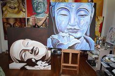 rachel milic with 2 large buddha paintings in progress