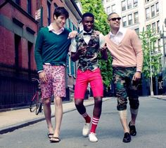 The Hipster Military Look for Men -- this is a different look for men than the traditional military look. However, by incorporating aspects of military-ness, a casual outfit can take on a different meaning. It is ironic to see the middle man breaking traditional gender binaries by combining pink with his camouflage vest.