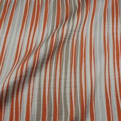 Random width stripes in orange, taupe and silver on an ivory background. Pairs beautifully with Papaya Matte Satin, Silver Matte Satin and Taupe Roma Silky. Coordinates with Stitch Orange.Luxury Pattern