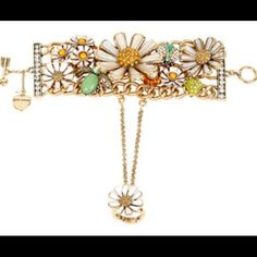 """NWT Betsey Johnson Glamorous 3D Daisy Bracelet NWT AUTHENTIC BETSEY JOHNSON  RETAILS FOR $145  When it comes to purely pretty accessories Betsey Johnson delivers. This bracelet comes complete with daisies and critters, with a gold-tone stretch ring with daisy at top.   Gold tone bracelet chains with daisies and critters Daisy ring with gold tone stretch ring shank Chain harness Toggle closure Antique gold Metal/glass/plastic 8mm Length: bracelet: 7.5""""; ring 1"""" / Width: bracelet: 1.9"""", ring…"""