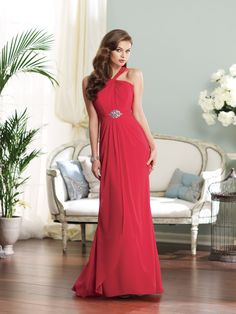 Chiffon A-line gown with inverted and twisted halter neckline over a satin sweetheart bodice, center gathered waistband with hand-beaded accent, corset back, split front draped overlay skirt. Available in all chiffon colors. Color shown: Red Sizes: 0 – 28