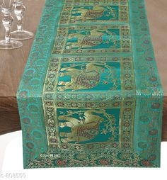 Table Runner Colorful Brocade & Poly Satin Table Runners Fabric: Poly Satin Size: Dimension (L X B) - 60 in X 16 in Description: It Has 1 Piece of Table Runner Work: Brocade Patch Work Sizes Available: Free Size *Proof of Safe Delivery! Click to know on Safety Standards of Delivery Partners- https://ltl.sh/y_nZrAV3  Catalog Rating: ★4.5 (260)  Catalog Name: Elegant Designer Poly Satin Table Runners Vol 2 CatalogID_92922 C129-SC1127 Code: 534-808550-