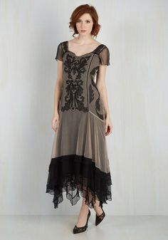 The magical moments you spend in this black and taupe gown will become your most cherished memories! Embroidered with stunning patterns atop its mesh overlay, and given a romantic touch via a corset-like back detail, this vintage-inspired maxi is noteworthy in every way.