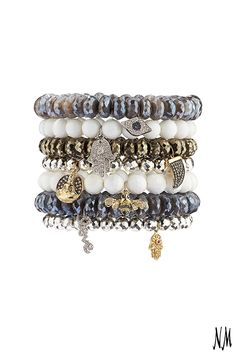 A stck of beaded bracelets by Sydney Evan instantly add style to any outfit. Mix and match metals and contrast colors for a truly modern look.