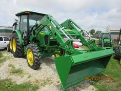 John Deere 5065E cab tractor with H240 loader