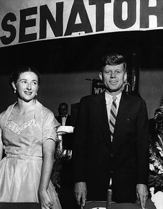 1953. 29 Octobre. Photo of Senator John F. Kennedy at a New Hampshire Young Democrats' banquet and dance. Pictured with him is Mary Farmer, who was the Deputy Sheriff of Hillsborough County, New Hampshire. At the time the photo was taken, he had been a senator for less than one year, having been elected to that position in November 1952 and taking office in January 1953. The Hands provided the photo to the Recorder-American newspaper for publication