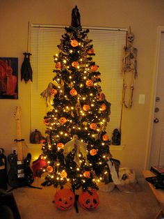 Break out your Christmas tree early and use it as a Halloween tree!