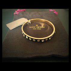 "Kate Spade Spotlight Bangle Bracelet 14k gold plated and black enamel bracelet. Kate Spade logo embossed on inside. Comes with dust bag. 2.25"" dia. Last photo cred: katespade.com kate spade Jewelry Bracelets"