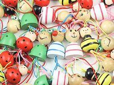 Grote gelukspoppetjes in de vorm van een lieveheersbeestje, kikkertje, muisje, konijntje of bijtje.