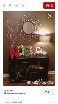 Love the NOEL letters.Front entry way: hurricane filled with pine cones and spray painted branches & NOEL letters. Christmas Time Is Here, Merry Little Christmas, Christmas Love, Winter Christmas, All Things Christmas, Christmas Letters, Decoration Table, Xmas Decorations, Painted Branches