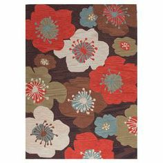 Add a pop of style to your living room or master suite with this eye-catching rug, showcasing a bold oversized floral motif in brown and red.  Product: RugConstruction Material: 100% PolyesterColor: Brown and redFeatures:  Hand-tuftedNote: Please be aware that actual colors may vary from those shown on your screen. Accent rugs may also not show the entire pattern that the corresponding area rugs have.Cleaning and Care: Blot spills immediately. Vacuum regularly with an attachment arm or ...