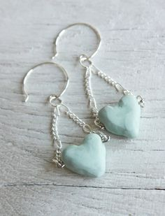Rustic blue heart polymer clay dangle earrings (shown in winter blue). Finished with a satin glaze for a nice look and extra durability.