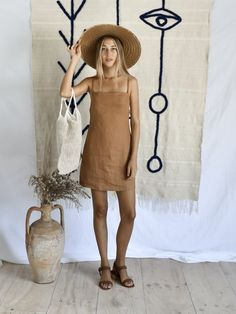 HEIDA DRESS | RUST Slip dress with thin straps in 100% Rust linen Also available in Grey linen Cool machine wash. line dry. cool iron. do not bleach. please use environmentally friendly detergents