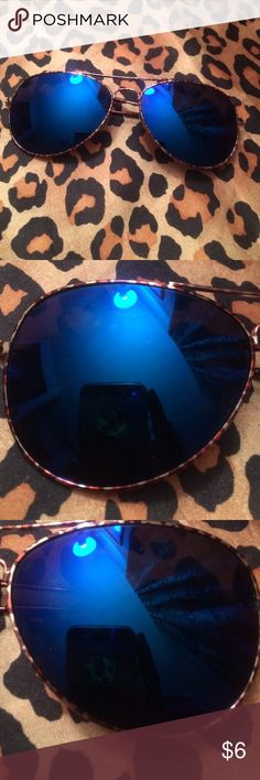 Rue 21 Sunglasses New, never used but have some slight yet unnoticeable scratches on the front lenses. The fronts are a mirrored blue, the backs are black. The rim of the glasses are gold with animal print. These have UV 400 protection. Rue 21 Accessories Glasses