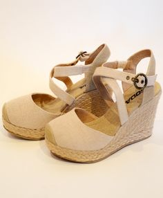 Jules is a closed toe linen wedge with an ankle strap and straw bottom. It is the perfect shoe to dress up an outfit or make it casual! The wedge is only 2 1/2 inches, so they are a perfect shoe! For girls learning to walk in heels to the mature woman that likes a comfortable shoe, Jules is a great fit!