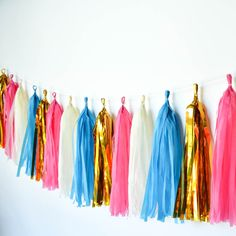 Slumber Party....? This bold, bright and gold birthday banner would be just perfect for her first slumber party or a girl's sleepover! Turquoise, fuchsia, creamy ivory and metallic gold tissue tassel garland, ships free on TwigsandTwirls.com