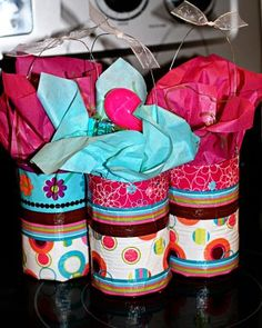 soup cans made into easter baskets with mod podge, wire, ribbon and grass