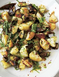This simple roasted eggplant recipe with seasoned potatoes doesn't take long to cook, and can be served alongside a rich stew or as part of a spread of meze-type dishes.data-pin-do=
