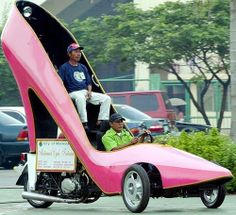 Motor cycle made into giant pink shoe to promote the shoe-making industry of Marikina in the Philippines.
