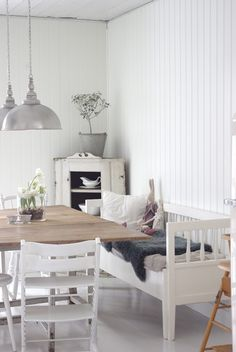 Zinc and white country styling. Couch as table seating