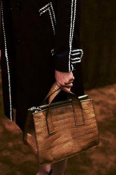 Light brown leather handbag backstage at Prada SS15, Milan menswear. More images here: http://www.dazeddigital.com/fashion/article/20425/1/prada-ss15