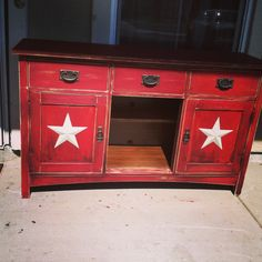 An Old China hutch turned in to my Tv table now,stars are from Michael's...just a little barn red and some distressing and listo!