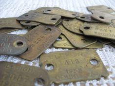 Vintage Brass Dog License Tags Lot of 4, Brass Number Tags, Steampunk DIY Kit, Vintage Found Objects, Jewelry Supplies, Mixed Media 40SP. $6.75, via Etsy.