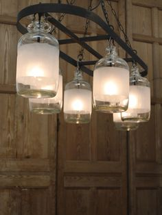 Six light distillery bottle chandelier