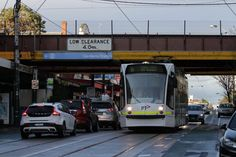 D1.3516 heads north on route 16 under the railway bridge at Glenferrie station