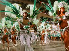 A samba school performs during the annual Carnival parade in Rio de Janeiro, Brazil. The 14 samba schools are the main attraction of Rio's Carnival, performing to approximately spectators in a stadium built especially for the celebration. Festival Dates, Winter Festival, Samba, Arte Complexa, Brazil Culture, School Must Haves, Caribbean Carnival, Brazil Travel, Festivals Around The World