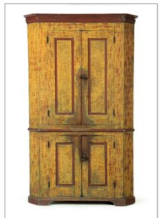 """Garth's.  Sale 1084 Lot 46 Mar 16 2013. Sold for $3,055.   DECORATED CORNER CUPBOARD.  American, 2nd quarter-19th century, poplar. One piece with four raised-panel doors, bracket base, and old red and yellow paint decoration. 80.5""""h. 48.5""""w. 23.5""""d., requires a 32"""" corner.  Estimate $ 2K- 4K."""