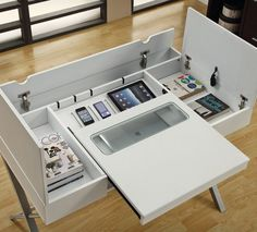 The Hollow Core Connect IT desk (also in cappucinno) has a hidden storage compartment to let you store, charge, connect, and organize all your handheld electronics and accessories.  Flip-to-open wire management: easy-access wire connection and storage; Slide-to-open handheld electronics compartment to connect, charge, store & interface with computer; two Flip-to-open storage compartments for accessories. Built-in power-surge protected outlet bar with telephone, internet & 2 USB hub…