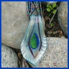 Artisan Collection Blown Glass Necklace I'll simply use the description as written. Art glass pendant created using master craftsmanship with artistic European flare. This necklace is fashioned using a fire blown glass shape. Intricately layered with the richness of genuine silver or gold foil. Carefully enhanced with hand painted designs then sealed with clear glass. Photo 1 outdoor lighting. Multi colored beads hold the pendant. Includes an alternate suede cord. None Jewelry Necklaces