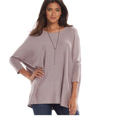 Host Pick 10/12 Scoopneck Tunic Sweater Brand new with tags! Featuring an oversize fit and dolman sleeves with snap accents, you'll love the modern style of this women's Jennifer Lopez caftan sweater.  PRODUCT FEATURES Tunic length Snap accents on the sleeves 3/4-length dolman sleeves Scoopneck FABRIC & CARE Sweaters