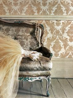okay - i love:      rococo wallpaper and sofa in brocade;  tulle and lace wedding dress; intricate gold necklace