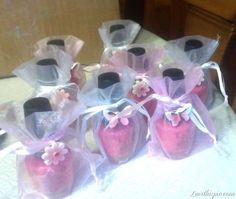 Cute baby shower favors! Blue for boy or teal a more modern color and pink for a girl or both foe a gender reveal. Except I would use clear plastic gift wrap and tie it with a cute ribbon!