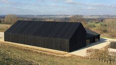 Black barn built by Macdonald Wright at Caring Wood country house