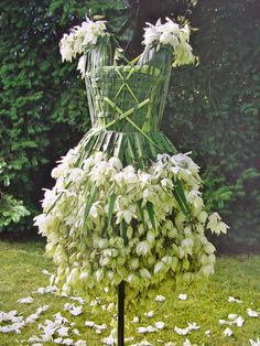 Environmental Dress Imagine how much time it would take to make this? I really like the amazing and fine detail made with the weaving of the leaves
