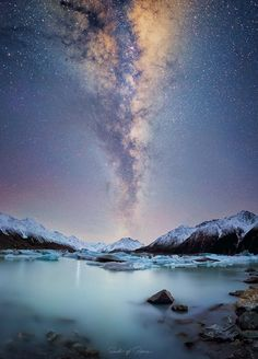 Tasman Glacier, NZ under the Milky Way - it was a very surreal feeling sitting in front of this glacial lake in the middle of the night! [OC] [1437 x 2000] : EarthPorn
