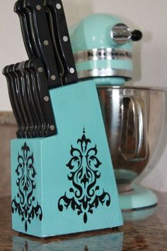 Upcycling Old Knife Holder - Sand, Paint, and Decorate: You see knife blocks ALL THE TIME at goodwill. Match your kitchen colors. Easy stick on designs.
